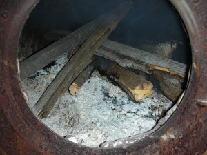 Layer wood pieces to allow plenty of airflow to keep fire burning. Image by Aprille Ross