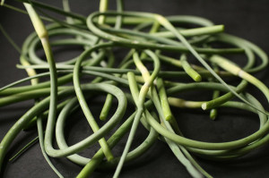 Grow your own garnishes or stir fry ingredients. These garlic scapes are delicious! Photo: thebittenword / CC by 2.0
