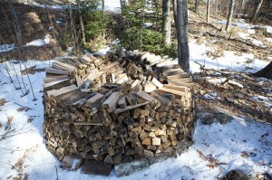 Now we're getting into the fancy stuff. Here's a nice round pile someone has started. With these, you can get the wood stacked up fairly high and the pile looks cool as well. Flickr photo by Chiot's Run