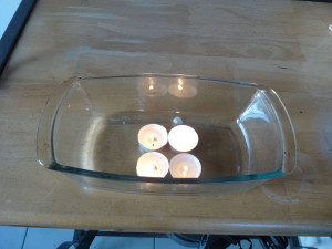 Light candles in a loaf dish.