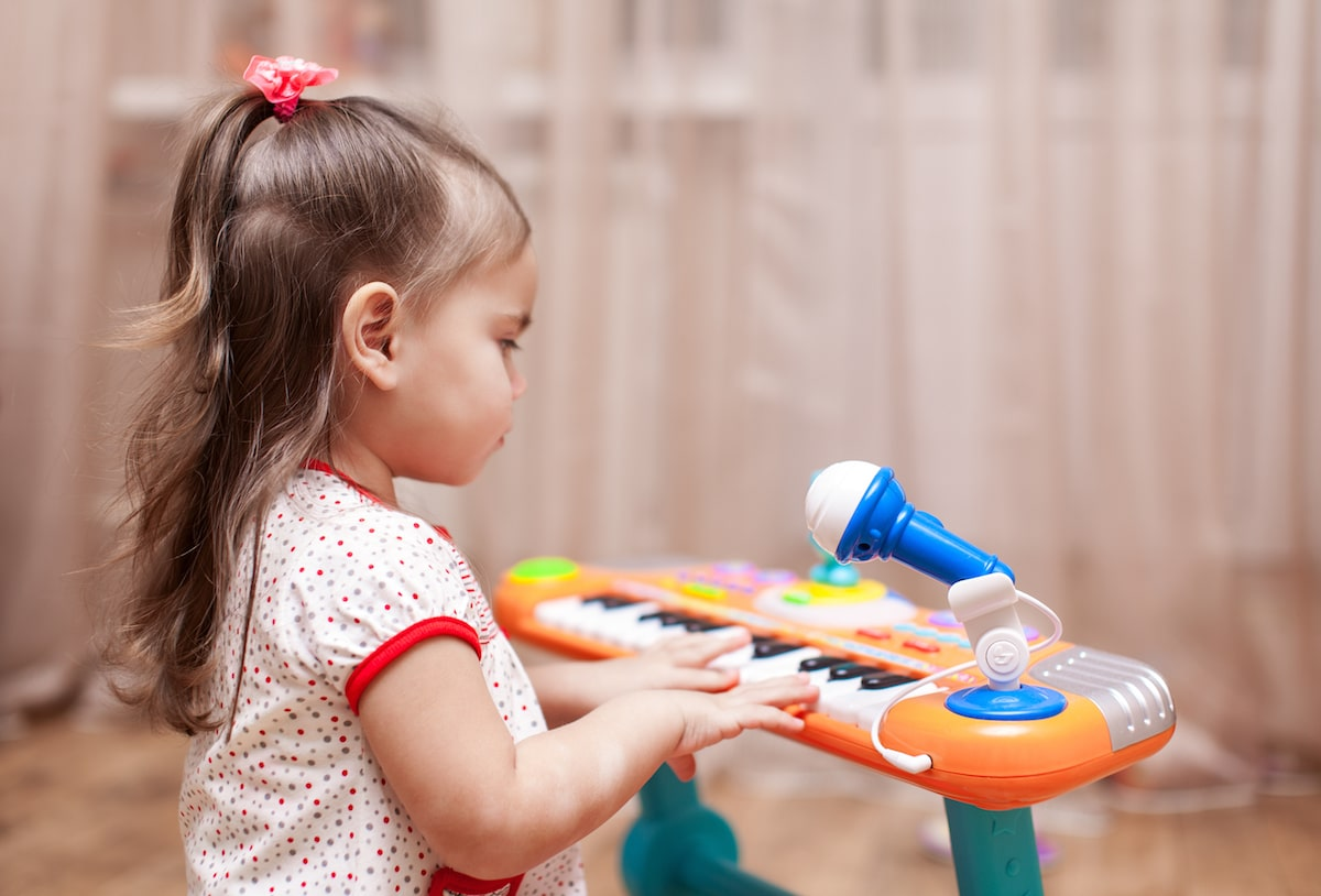 Child Playing with toy piano