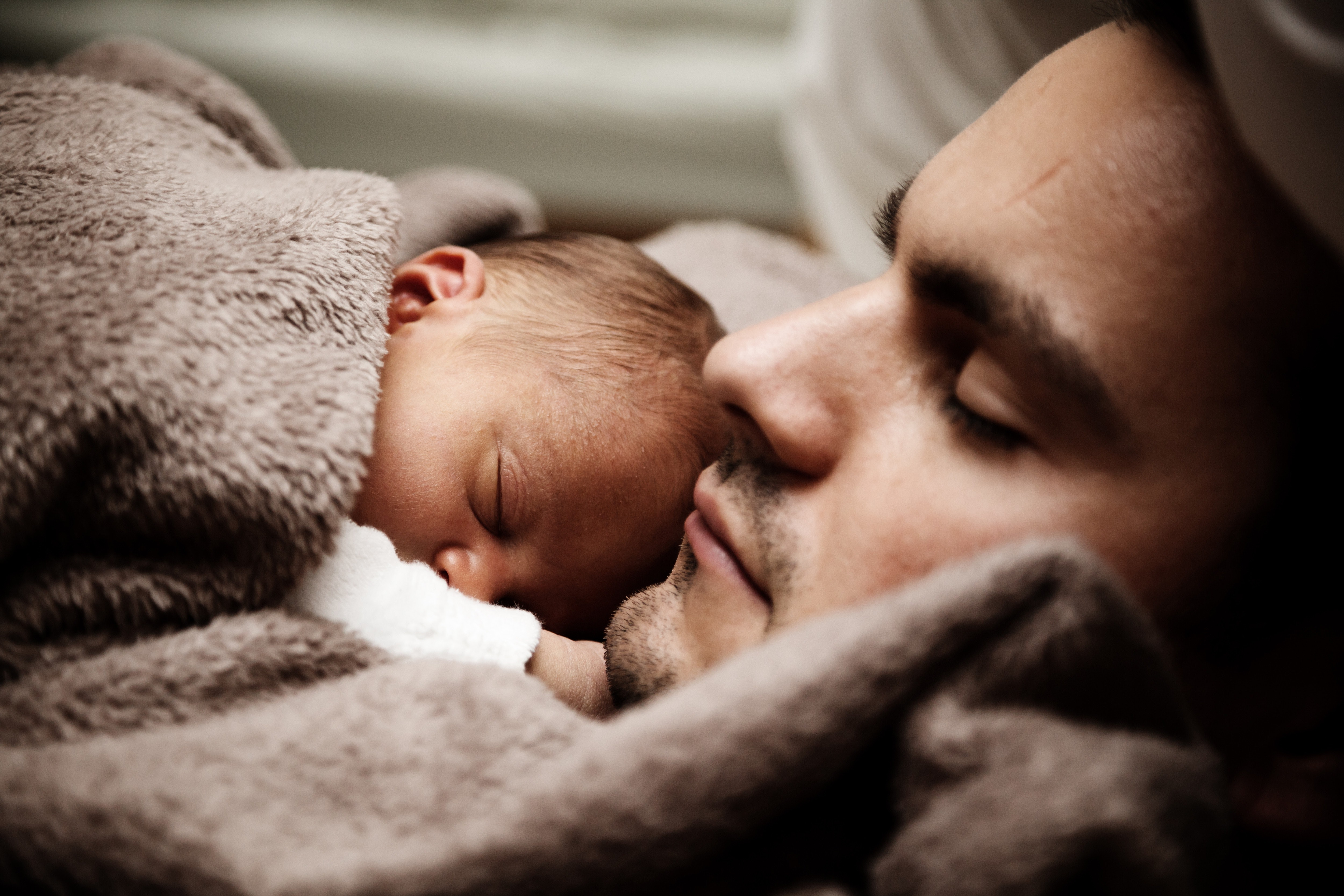 co-sleeping father and baby